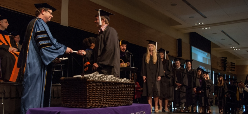 Department Chair Prof. George Lovell presenting letters of congratulations to undergraduates