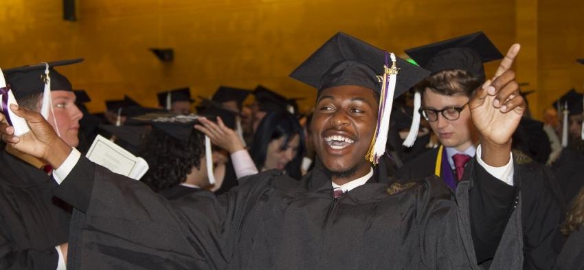 Undergraduate celebrating graduating