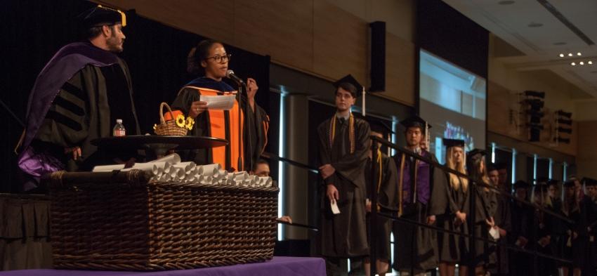 Prof. Megan Ming Francis announcing undergraduates