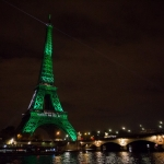 The Eiffel Tower Is Illuminated in Green to Celebrate Paris Agreement's Entry into Force