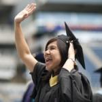 UW grad waving