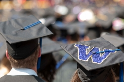 """Graduation caps with """"W"""" on top of one of them"""