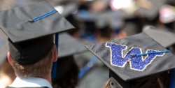 """Convocation caps with """"W"""" on top of one of them"""
