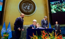 Signing of Paris Agreement on Climate Change. U.S. Secretary of State John Kerry, with his two-year-old granddaughter Isabelle